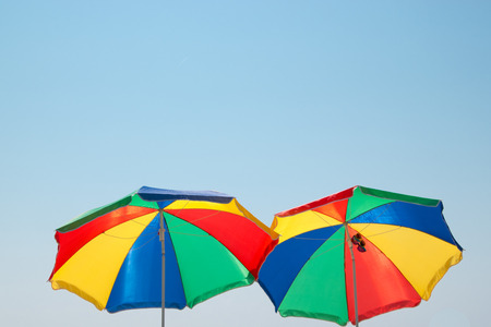 Colorful parasols in front of blue sky