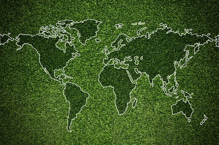 World map on artificial turf green photo