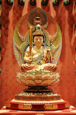 The statue of Buddha, Chinese Buddha Tooth Relic. Design patterns in the wall. Side of the corridor. photo