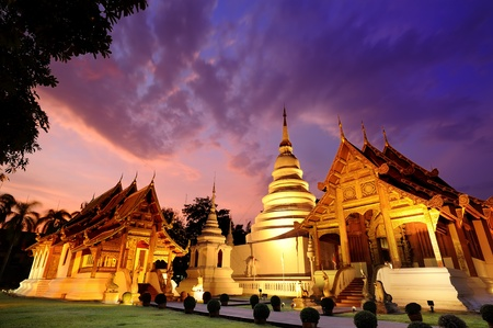 Phra Singh temple twilight time Viharn Lai Kam Wat Phra Singh is located in the western part of the old city centre of Chiang Mai.
