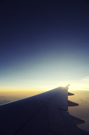 Airplane travel time is sunset, cross process style. Stock Photo - 14107309