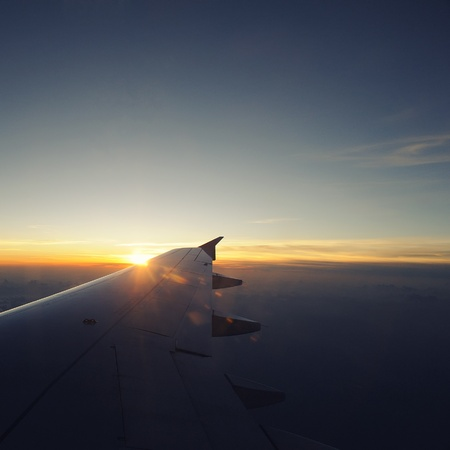 Airplane travel time is sunset, cross process style. Stock Photo - 14208102