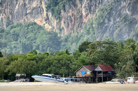 The homes of the fishermen. The tourists who come to the sea. And a variety of activities on the beach, Krabi, Thailand. photo