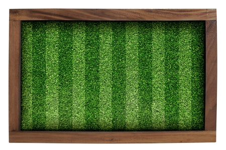 Wood frame and artificial turf green isolated on white background  photo