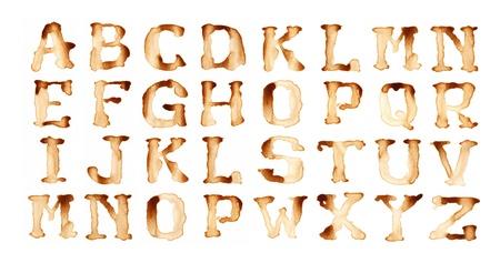 graffiti brown: Escritura del alfabeto de caf� al estilo antiguo Foto de archivo