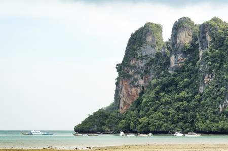 RAILAY travel steep cliffs. A popular tourist climb the cliff. Krabi Thailand. photo