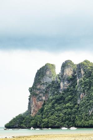steep cliffs: RAILAY travel steep cliffs. A popular tourist climb the cliff. Krabi Thailand.