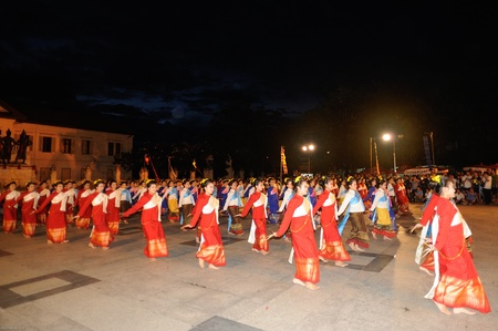 CHIANGMAI,THAILAND- AUGUST 26:Dance is offerings to Princess Dara Rasmi.300 people dedicated to the beautiful women dance at Three Kings Monument plaza. on August 26,2012 in Chiangmai,Thailand.