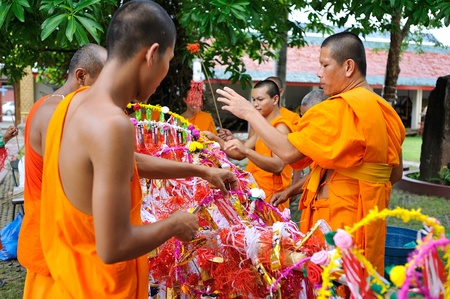 LAMPHUN,THAILAND - SEPT. 29 : Salak Yom tradition,Traditionally done since ancient times to the present. Merit for the deceased ancestors. at Hariphunchai temple on Sept. 29, 2012 in Lamphun,Thailand