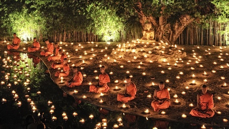CHIANG MAI THAILAND - NOVEMBER 28 : Loy Krathong festival in Chiangmai.Group of monks sitting meditation in the sacred ritual at Wat Phan Tao temple.on November 28, 2012 in Chiangmai,Thailand.
