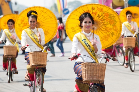 chiang mai: CHIANG MAI, THAILAND-JANUARY 18 : 30th anniversary Bosang umbrella festival,Woman in traditional costume during the annual Umbrella festival at San Kamphaeng. on Jan.18, 2013 in Chiang Mai, Thailand. Editorial