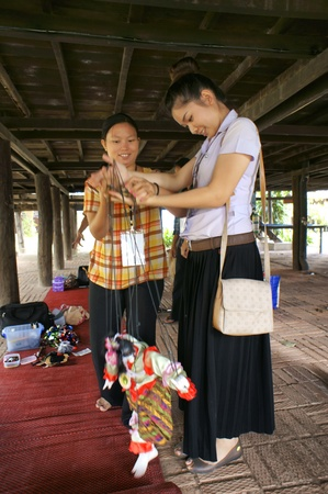 hoon: CHIANG MAI THAILAND-FEB. 23 : ASEAN Enchanting Puppets 2013.Unidentified woman identity Hoon sai Marionettes of Myanmar at CMU. Art Center.on FEB. 23,2013 in Chiangmai,Thailand