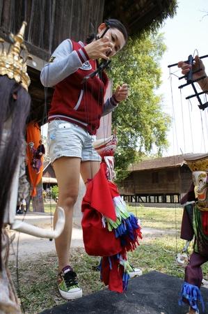 hoon: CHIANG MAI THAILAND-FEB. 23 : ASEAN Enchanting Puppets 2013.Unidentified woman play identity Hoon sai Sema Marionettes of Thailand at CMU. Art Center.on FEB. 23,2013 in Chiangmai,Thailand Editorial