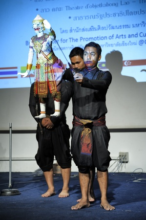 joe louis: CHIANG MAI THAILAND-FEB. 23 : ASEAN Enchanting Puppets 2013.Unidentified man dance gestures and pantomime Thailand at The CMU. Art Center.on FEB. 23,2013 in Chiangmai,Thailand