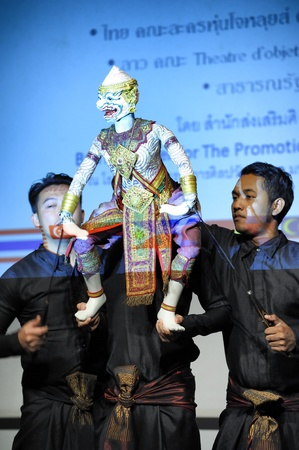 CHIANG MAI THAILAND-FEB. 23 : ASEAN Enchanting Puppets 2013.Unidentified man dance gestures and pantomime Thailand at The CMU. Art Center.on FEB. 23,2013 in Chiangmai,Thailand Stock Photo - 18833138