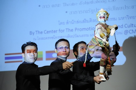 enchanting: CHIANG MAI THAILAND-FEB. 23 : ASEAN Enchanting Puppets 2013.Unidentified men dance gestures and pantomime Thailand at The CMU. Art Center.on FEB. 23,2013 in Chiangmai,Thailand
