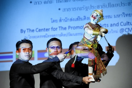 CHIANG MAI THAILAND-FEB. 23 : ASEAN Enchanting Puppets 2013.Unidentified men dance gestures and pantomime Thailand at The CMU. Art Center.on FEB. 23,2013 in Chiangmai,Thailand Stock Photo - 18833135