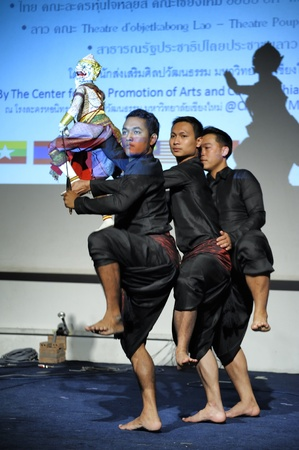 CHIANG MAI THAILAND-FEB. 23 : ASEAN Enchanting Puppets 2013.Unidentified men dance gestures and pantomime Thailand at The CMU. Art Center.on FEB. 23,2013 in Chiangmai,Thailand Stock Photo - 18833133