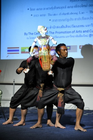CHIANG MAI THAILAND-FEB. 23 : ASEAN Enchanting Puppets 2013.Unidentified men dance gestures and pantomime Thailand at The CMU. Art Center.on FEB. 23,2013 in Chiangmai,Thailand Stock Photo - 18833132