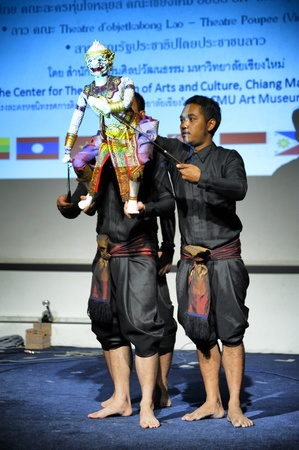 CHIANG MAI THAILAND-FEB. 23 : ASEAN Enchanting Puppets 2013.Unidentified men dance gestures and pantomime Thailand at The CMU. Art Center.on FEB. 23,2013 in Chiangmai,Thailand Stock Photo - 18833272
