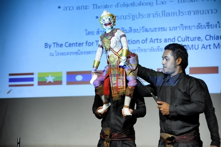 CHIANG MAI THAILAND-FEB. 23 : ASEAN Enchanting Puppets 2013.Unidentified men dance gestures and pantomime Thailand at The CMU. Art Center.on FEB. 23,2013 in Chiangmai,Thailand Stock Photo - 18833249