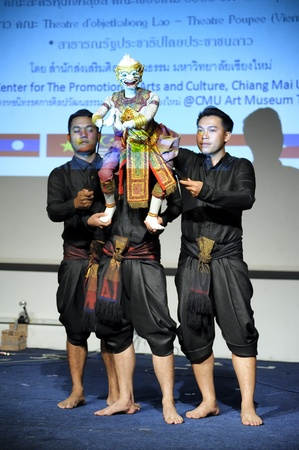 joe louis: CHIANG MAI THAILAND-FEB. 23 : ASEAN Enchanting Puppets 2013.Unidentified men dance gestures and pantomime Thailand at The CMU. Art Center.on FEB. 23,2013 in Chiangmai,Thailand