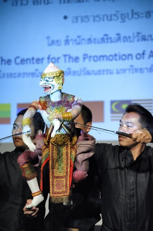 CHIANG MAI THAILAND-FEB. 23 : ASEAN Enchanting Puppets 2013.Unidentified men dance gestures and pantomime Thailand at The CMU. Art Center.on FEB. 23,2013 in Chiangmai,Thailand Stock Photo - 18833265
