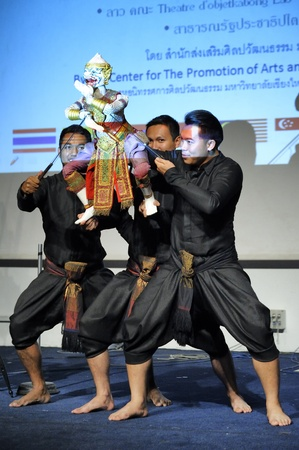CHIANG MAI THAILAND-FEB. 23 : ASEAN Enchanting Puppets 2013.Unidentified men dance gestures and pantomime Thailand at The CMU. Art Center.on FEB. 23,2013 in Chiangmai,Thailand Stock Photo - 18833253