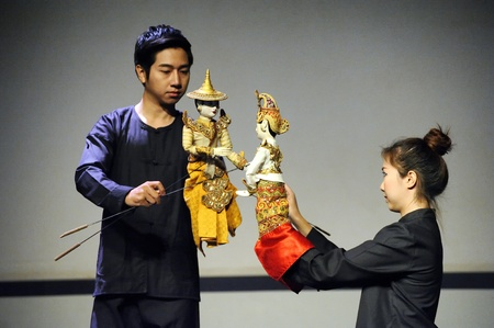 hobby hut: CHIANG MAI THAILAND-FEB. 23 : ASEAN Enchanting Puppets 2013.Unidentified man and woman Hobby hut dance gestures and pantomime Thailand at The CMU. Art Center.on FEB. 23,2013 in Chiangmai,Thailand