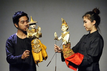 CHIANG MAI THAILAND-FEB. 23 : ASEAN Enchanting Puppets 2013.Unidentified man and woman Hobby hut dance gestures and pantomime Thailand at The CMU. Art Center.on FEB. 23,2013 in Chiangmai,Thailand Stock Photo - 18833274