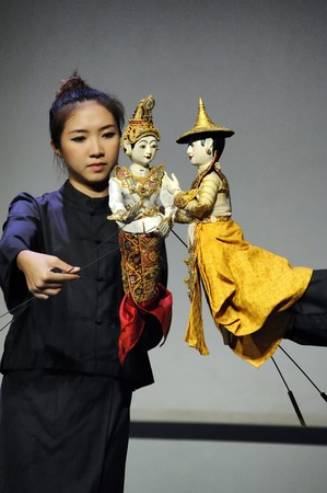 hobby hut: CHIANG MAI THAILAND-FEB. 23 : ASEAN Enchanting Puppets 2013.Unidentified woman Hobby hut dance gestures and pantomime Thailand at The CMU. Art Center.on FEB. 23,2013 in Chiangmai,Thailand Editorial