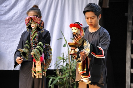 enchanting: CHIANG MAI THAILAND-FEB. 23 : ASEAN Enchanting Puppets 2013.Unidentified man and woman Hobby hut dance gestures and pantomime Thailand at The CMU. Art Center.on FEB. 23,2013 in Chiangmai,Thailand