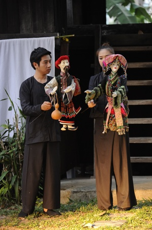 CHIANG MAI THAILAND-FEB. 23 : ASEAN Enchanting Puppets 2013.Unidentified man and woman Hobby hut dance gestures and pantomime Thailand at The CMU. Art Center.on FEB. 23,2013 in Chiangmai,Thailand Stock Photo - 18833243