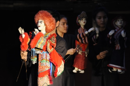 CHIANG MAI THAILAND-FEB. 23 : ASEAN Enchanting Puppets 2013.Unidentified man and woman Hobby hut dance gestures and pantomime Thailand at The CMU. Art Center.on FEB. 23,2013 in Chiangmai,Thailand Stock Photo - 18833234