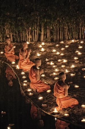 CHIANG MAI THAILAND-FEBRUARY 25 : Makha Bucha Day.Traditional buddhist monks are lighting candles for religious ceremonies at Wat Phan Tao temple.on FEB. 25,2013 in Chiangmai,Thailand