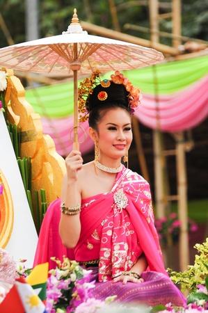 CHIANG MAI,THAILAND-FEB.2 : 37th Anniversary Chiang Mai Flower Festival, Unidentified woman in parade annual Chiang Mai flower festival. on Feb.2, 2013 in Chiang Mai,Thailand. Stock Photo - 18883788