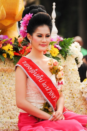 CHIANG MAI,THAILAND-FEB.2 : 37th Anniversary Chiang Mai Flower Festival, Unidentified woman in parade annual Chiang Mai flower festival. on Feb.2, 2013 in Chiang Mai,Thailand. Stock Photo - 18883700