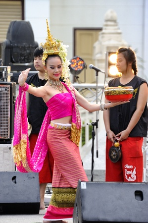 CHIANG MAI THAILAND-March 8 : CHIANG MAI FEST 2013.Unidentified women's costumes are traditional dance opening ceremony at King monument plaza.on March 8,2013 in Chiangmai,Thailand