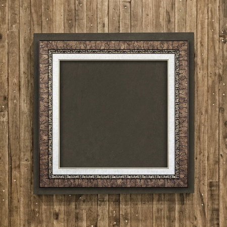 Antique frame on wood background photo