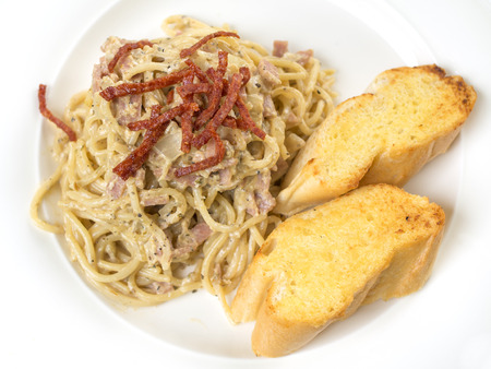 Spaghetti Carbonara and garlic bread photo