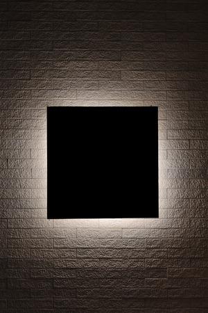 shadow show: Black sign on modern brick wall Stock Photo