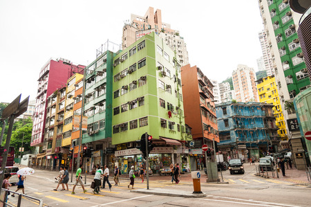 HONG KONG , CHINA - JULY 7   Hong Kong houses are often painted to be friendly shopping area and most people walk to shopping at Queen s road east  on July 7,2014 in Hong Kong