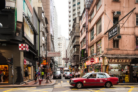 HONGKONG , CHINA-JULY 7   Lifestyles of Hong Kong popular walking and taxi service  Because space is limited, so the city seemed more crowded dwellings  at Matheson Street on July 7,2014 in Hong Kong