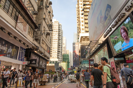 lowrise: HONG KONG , CHINA - JULY 9 : Market in Mongkok zone, It is zone trading of a variety, Tourists often visit a popular souvenir. (Do not miss a tourist attraction). on July 9, 2014 in Hong Kong, CHINA.