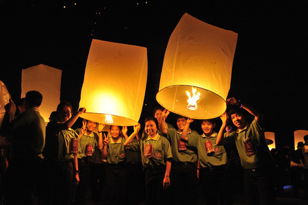 yeepeng: CHIANG MAI THAILAND - OCTOBER 25 : The Floating Lanterns Tudong - Khasathan festival. Tourist lights floating lanterns made of paper annually at the Sansai. on Oct. 25, 2014 in Chiang Mai, Thailand. Editorial