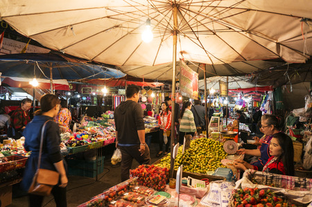 fruit trade: CHIANG MAI THAILAND - JANUARY 13 : Warorot Market, Popular tourist food and visit the local fruit market is be held everyday. on January 13 , 2015 in Chiang Mai, Thailand.