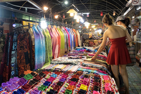 architectural lighting design: CHIANG MAI THAILAND - MARCH 10 : Night Bazaar market, Unidentified tourist womens shopping for clothes in the night market. on March 10 , 2015 in Chiang Mai, Thailand.