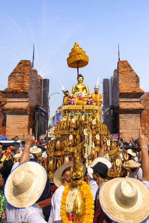 chiangmai: CHIANG MAI THAILAND - APRIL 13 : Chiangmai Songkran festival.The tradition of bathing the Buddha Phra Singh marched on an annual basis. With respect to faith. on April 13, 2015 in Chiangmai,Thailand. Editorial