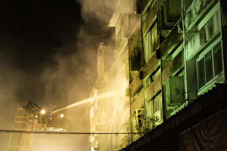 CHIANGMAI THAILAND  JUNE 5 : Warorot market fire. Firefighters were spraying water to extract the fire from spreading to adjacent buildings. on June 5  2015 in Chiang MaiThailand.