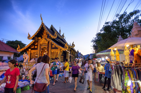 CHIANG MAI THAILAND  JUNE 7 : Sunday market walking street The city center Thai temple marketing and trading of local tourists come to buy as souvenirs. on June 7 2015 in Chiang Mai Thailand.